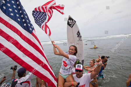Tia Blanco U.S. Tia Blanco, center, waves a flag as she celebrate after winning the final of the Nicaragua Unica Original World Surfing Games ISA championship in Tola, Nicaragua