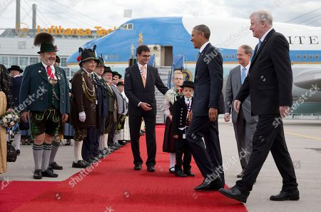 Barack Obama, Horst Seehofer, John B. Emerson US President Barack Obama, joined by Horst Seehofer, Minister President of Bavaria, right, and US Ambassador to Germany John B. Emerson, second from right, is greeted by traditionally dressed Bavarian men and women as he arrives on Air Force One at the airport in Munich, southern Germany, en route to the G-7 summit at the Schloss Elmau hotel near Garmisch-Partenkirchen, southern Germany