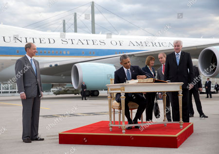 Barack Obama, Horst Seehofer, John B. Emerson US President Barack Obama, joined by Horst Seehofer, Minister President of Bavaria, right, and US Ambassador to Germany John B. Emerson, left, signs a guest book as he arrives on Air Force One at the airport in Munich, southern Germany, en route to the G-7 summit at the Schloss Elmau hotel near Garmisch-Partenkirchen, southern Germany