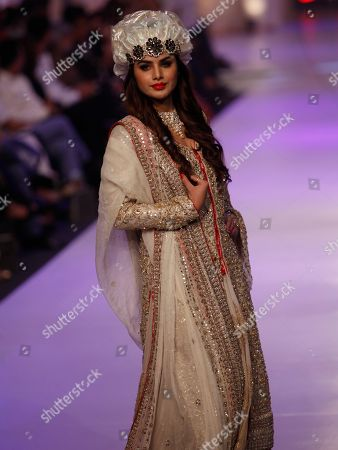 Stock Picture of A model presents creations by Pakistani designer Rizwan Ahmed at Bridal Couture Week 2015, in Karachi, Pakistan