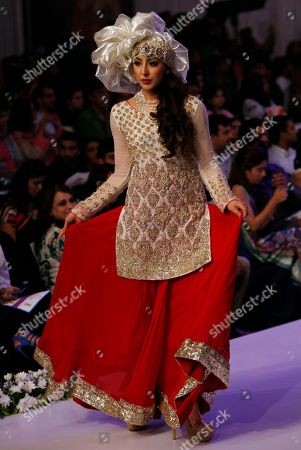 Stock Photo of A model presents creations by Pakistani designer Rizwan Ahmed at Bridal Couture Week 2015, in Karachi, Pakistan