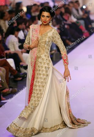A model presents creations by Pakistani designer Rizwan Ahmed at Bridal Couture Week 2015, in Karachi, Pakistan