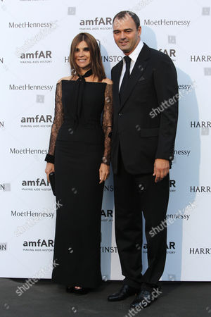 Carine Roitfeld, left, and Milutin Gatsby arrive for the AMFAR dinner, in Paris, France. AmfAR, the Foundation for AIDS Research, is one of the world's leading nonprofit organizations dedicated to the support of AIDS research and HIV prevention