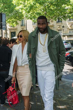 Stock Photo of U.S basketball player Amar'e Stoudemire, right, and his wife Alexis Welch arrive at Balmain men's Spring/Summer 2016 collection, during Mode a Paris, in France