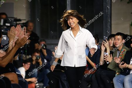 French designer Veronique Nichanian acknowledges applause at the end of Hermes men's Spring/Summer 2016 fashion collection, presented in Paris, France