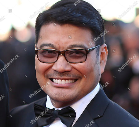 """Ronnie del Carmen Director Ronnie del Carmen poses for a photo upon arrival for the screening of the film """"Inside Out"""" at the 68th international film festival, Cannes, southern France. The Filipino-American co-director of the highly successful animated movie """"Inside Out"""" said that it's a dream come true for him to share with Filipinos a film he helped create"""