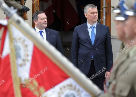 Jason Kenney, Tomasz Siemoniak Canadian Defence Minister Jason Kenney, left, and his Polish counterpart Tomasz Siemoniak watch the marching guard of honor prior to talks in Warsaw, Poland