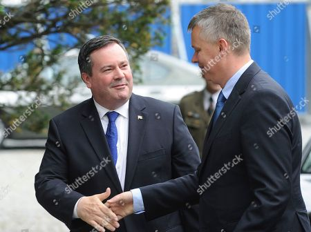 Jason Kenney, Tomasz Siemoniak Canadian Defence Minister Jason Kenney, left, and his Polish counterpart Tomasz Siemoniak shake hands prior to talks in Warsaw, Poland