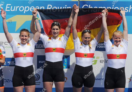 Lisa Schmidla,Carina Baer,Marie-Catherine Arnold, Annekatrin Thiele Gold medalist from Germany, Lisa Schmidla, left, Carina Baer, second left, Marie-Catherine Arnold and Annekatrin Thiele, right, celebrate during the medal ceremony after the Women's Quadruple Sculls final at the European Rowing Championships in Poznan, Poland