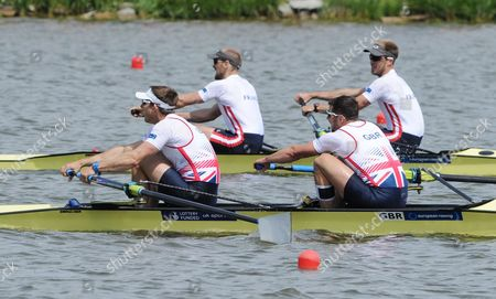 Stock Picture of Matt Langridge,James Foad, Dorian Mortelette, Germain Chardin Great Britain's Matt Langridge, left, and James Foad, second right, compete with France's Dorian Mortelette, second left, and Germain Chardin in the Men's Pair final at the European Rowing Championships in Poznan, Poland