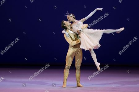 Dorothee Gilbert, Hugo Marchand French soloists of the Opera de Paris Dorothee Gilbert and Hugo Marchand, choreographed by Rudolf Nureyev, perform during a Gala Concert in the Bolshoi Theater in Moscow, Russia