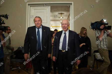James Watson, Vladimir Fortov U.S. Nobel laureate, biologist James Watson, right, walks alongside President of the Russian Academy of Sciences Vladimir Fortov during his visit to the Russian Academy of Sciences, in Moscow, Russia, . Watson, who was awarded Nobel prize in 1962 for a discovery in the DNA studies, said he was going to give support to young scientists from Russia and China. His Nobel medal that was sold at an auction to Russian businessman Alisher Usmanov last year, was returned to him during his visit