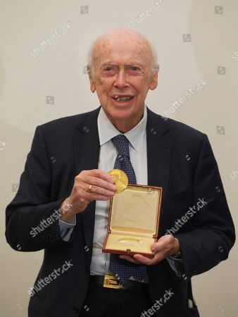 James Watson U.S. Nobel laureate biologist James Watson shows his Nobel medal that was returned to him during his visit to the Russian Academy of Sciences, in Moscow, Russia, . Watson, who was awarded Nobel prize in 1962 for a discovery in the DNA studies, said he was going to give support to young scientists from Russia and China. His Nobel medal that was sold at an auction to Russian businessman Alisher Usmanov last year, was returned to him during his visit