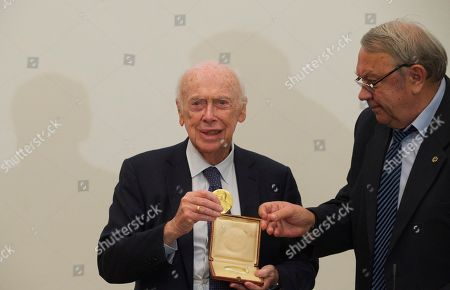 James Watson, Vladimir Fortov President of the Russian Academy of Sciences Vladimir Fortov, right, returns a Nobel medal to U.S. Nobel laureate, biologist James Watson in the Russian Academy of Sciences, in Moscow, Russia, . Watson, who was awarded Nobel prize in 1962 for a discovery in the DNA studies, said he was going to give support to young scientists from Russia and China. His Nobel medal that was sold at an auction to Russian businessman Alisher Usmanov last year, was returned to him during his visit