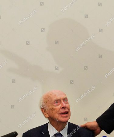 James Watson U.S. Nobel laureate, biologist James Watson speaks in the Russian Academy of Sciences, in Moscow, Russia, . Watson, who was awarded Nobel prize in 1962 for a discovery in the DNA studies, said he was going to give support to young scientists from Russia and China. His Nobel medal that was sold at an auction to Russian businessman Alisher Usmanov last year, was returned to him during his visit