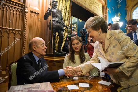 Valery Giscard d'Estaing, Naina Yeltsin Former French President Valery Giscard d'Estaing shakes hands with Naina Yeltsin, widow of first Russian President Boris Yeltsin, after signing his book at a presentation of his book La Victoire de la Grande Armée in Moscow, Russia, . In center is an interpreter