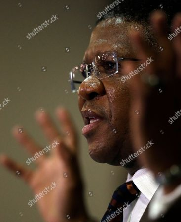 "South Africa's sports minister Fikile Mbalula gestures as he speaks during a news conference in Johannesburg, South Africa, . Mbalula ""categorically"" denied on Wednesday that the $10 million paid to former FIFA official Jack Warner in 2008 was a bribe for his help in securing the World Cup"