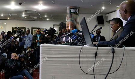 "South Africa's sports minister Fikile Mbalula, second from right, reads a statement during a news conference in Johannesburg, South Africa, . Mbalula ""categorically"" denied on Wednesday that the $10 million paid to former FIFA official Jack Warner in 2008 was a bribe for his help in securing the World Cup"