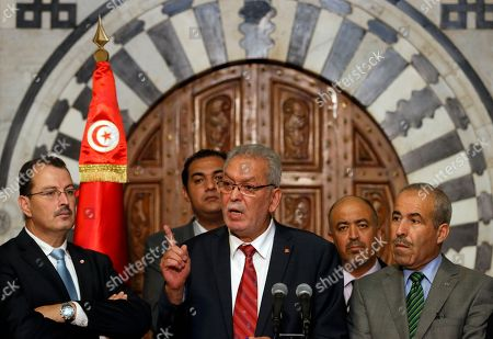 Kamel Jendoubi, Minister to the Prime Minister in charge of Relations with Constitutional Bodies and the Civil Society, center speaks during a press conference in Tunis, Tunisia, . The Islamic State group claimed responsibility for the attack, in which a Tunisian student opened fire on a beach in the resort of Sousse. The attacker was later killed by police