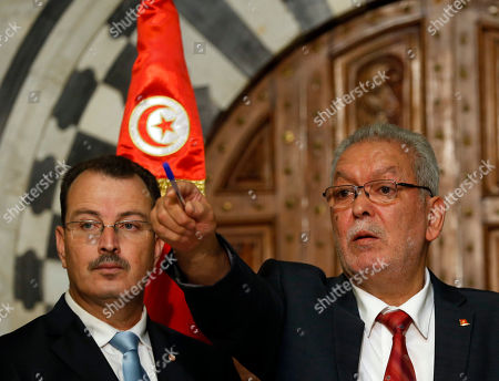 Kamel Jendoubi, Minister to the Prime Minister in charge of Relations with Constitutional Bodies and the Civil Society, right, gestures during a press conference in Tunis, Tunisia, . The Islamic State group claimed responsibility for the attack, in which a Tunisian student opened fire on a beach in the resort of Sousse. The attacker was later killed by police