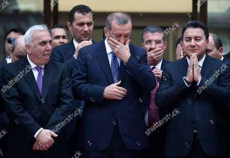 Recep Tayyip Erdogan Turkey's President Recep Tayyip Erdogan, center, accompanied by Huseyin Aydin, left, General Manager of Ziraat Katilim Bankasi, a new public investment bank and Ali Babacan, right, Turkey's Deputy Prime Minister pray during the opening ceremony for the bank, in Istanbul, Turkey, . Turkey will hold general election on June 7, 2015 and approximately 56 million Turkish voters are eligible to cast their ballots to elect the 550 members of the Grand National Assembly