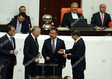 Stock Picture of Ismet Yilmaz, Ahmet Davutoglu, Ekmeleddin Ihsanoglu Turkey's Prime Minister Ahmet Davutoglu, right, Ismet Yilmaz, the ruling Justice and Development Party's candidate and the Defense Minister in the outgoing government, centre, and nationalist candidate Ekmeleddin Ihsanoglu, second left, chat as they cast their votes for a new Speaker at the Parliament in Ankara, Turkey, . Ismet Yilmaz - the ruling party's nominee and the defense minister in the outgoing government - won 258 votes Wednesday, beating the left-wing party's candidate in a face-off. The nationalist party cast invalid votes, implicitly helping Yilmaz take the post to lead Turkey's 550-seat parliament