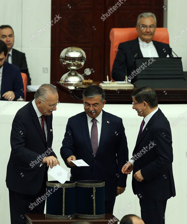 Ismet Yilmaz, Ahmet Davutoglu, Ekmeleddin Ihsanoglu Turkey's Prime Minister Ahmet Davutoglu, right, Ismet Yilmaz, the ruling Justice and Development Party's candidate and the Defense Minister in the outgoing government, centre, and nationalist candidate Ekmeleddin Ihsanoglu, left, chat as they cast their votes at the Parliament in Ankara, Turkey, . Yilmaz was elected with 258 votes of 550-parliament