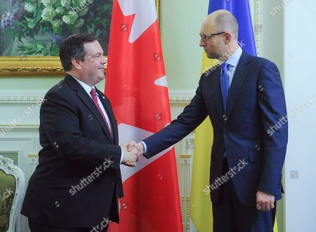 Arseniy Yatsenyuk,Jason Kenney Canadian Defence Minister Jason Kenney,left, and Ukrainian Prime Minister Arseniy Yatsenyuk shake hands during their meeting in Kiev, Ukraine