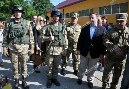 Stepan Poltorak, Jason Kenney Ukrainian Defense Minister Stepan Poltorak, right, and Canadian Defence Minister Jason Kenney, 2nd right, inspects a International Center for Peacemaking and Safety the Army Academy in the Lviv region, western Ukraine