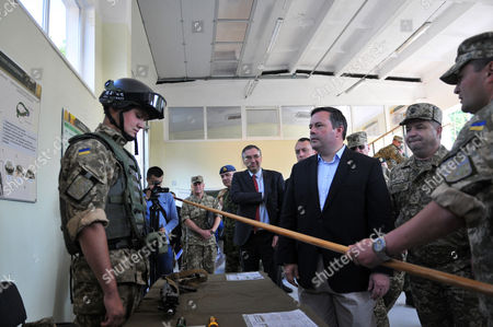 Stepan Poltorak, Jason Kenney Ukrainian Defense Minister Stepan Poltorak, 2nd right, and Canadian Defence Minister Jason Kenney, center, inspects a International Center for Peacemaking and Safety the Army Academy in the Lviv region, western Ukraine