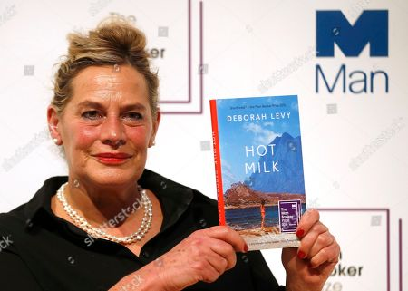 """Writer Deborah Levy, poses for the media with her book """"Hot Milk"""", during a photocall for the 6 shortlisted authors for the Man Booker Prize for fiction in London, . This will be the third year the £50,000 (61,000 US$), prize has been open to any writer, writing originally in English and published in the UK, irrespective of nationality"""