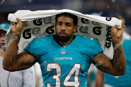 Stock Image of Arian Foster This Aug. 19, 2016 photo shows Miami Dolphins running back Arian Foster (34) walking along the sideline during an NFL preseason football game in Arlington, Texas. Four-time Pro Bowl running back Arian Foster has announced, his retirement midway through an injury-plagued season with the Miami Dolphins