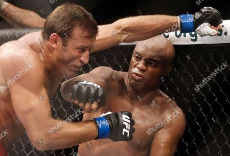 Anderson Silva, Stephan Bonnar Brazil's Anderson Silva, right, throws a punch at Stephan Bonnar, of the United States, during their light heavyweight mixed martial arts bout at UFC 153 in Rio de Janeiro, Brazil. Nevada fight regulators imposed the maximum penalty on former UFC champion Silva for testing positive for steroid use in January, 2015. Nevada Athletic Commission Chairman Francisco Aguilar said the 40-year-old Silva was suspended for one year, stripped of his January win over Nick Diaz and fined $380,000
