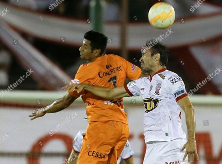Stock Picture of David Castro, Eduardo Dominguez David Castro, left, of Bolivia's Universitario de Sucre, fights for the ball with Eduardo Dominguez of Argentina's Huracan, during a Copa Libertadores soccer match in Buenos Aires, Argentina