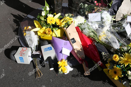 Flowers are placed at the foot of a statue of former Australia cricket captain Richie Benaud at the Sydney Cricket Ground following the death of Benaud in Sydney, . Benaud played 63 tests for Australia, making his debut against the West Indies in 1952 and culminating in 1964 against South Africa, a transformative period in the game