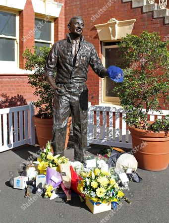 """Flowers are placed at the foot of a statue of former Australia cricket captain Richie Benaud at the Sydney Cricket Ground following the death of Benaud in Sydney, . Within hours of his death on Friday, April 10, 2015, former Australia cricket captain and pioneering television commentator Benaud was described as a """"national treasure"""" and praised by his peers, current players and the country's prime minister. Benaud played 63 tests for Australia, making his debut against the West Indies in 1952 and culminating in 1964 against South Africa, a transformative period in the game"""