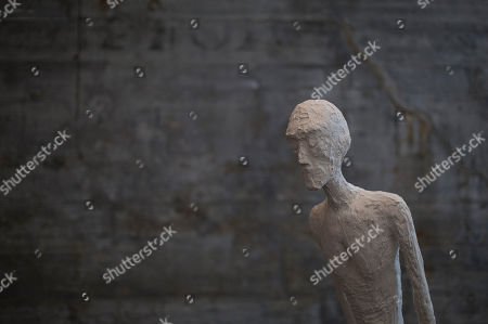 """A replica of late Swiss sculptor Alberto Giacometti's """"L'Homme qui marche I,"""" made out of Styrofoam, is displayed at an exhibit designed by Mexican artist Damian Ortega and titled """"End of Matter,"""" at the Modern Art Museum in Rio de Janeiro, Brazil. The exhibit's aim is to have the hall full of sculptures and all of the foam blocks used up when the exhibit ends on June 14"""