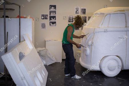 """Carnival sculptor Charles Rocha sculpts a VW van into Styrofoam, using a photograph as a guide, inside a studio at the Modern Art Museum for an exhibit titled """"End of Matter,"""" and designed by Mexican artist Damian Ortega, in Rio de Janeiro, Brazil. """"Here we have to arrive at a certain time, and the museum closes at a certain time,"""" said Rocha, who has been a """"carnavalesco,"""" or Carnival artisan, for two decades. """"At the samba schools, there's no such thing as a shift. When Carnival gets close, we work all day, all night and are at it until our arms give out"""