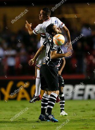 Stock Photo of Felipe, Luis Fabiano Felipe of Brazil's Corinthians, front, fights for the ball with Luis Fabiano of Brazil's Sao Paulo FC during a Copa Libertadores soccer match in Sao Paulo, Brazil