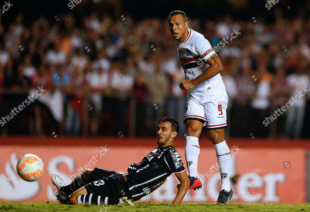 Luis Fabiano, Uendel Luis Fabiano of Brazil's Sao Paulo FC, right, strikes the ball to score his team's first goal as Uendel of Brazil's Corinthians looks on during a Copa Libertadores soccer match in Sao Paulo, Brazil