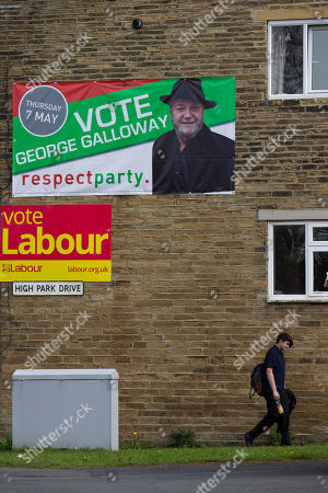 On, a person walks past a Labour Party poster, and a Respect Party poster, in the constituency of Bradford West, in Bradford, England, as Britain's political parties campaign in the lead up to the parliamentary elections on May 7. Labour candidate Naz Shah is running for Parliament, but she is hardly a typical British politician. She grew up in poverty, fled a teenage forced marriage and campaigned to free her mother, imprisoned for murder after poisoning an abusive partner. Her rival, George Galloway, is a left-wing firebrand who has denounced U.S. senators, saluted Saddam Hussein and once appeared on a reality-TV show pretending to be a cat. Anyone who thinks Britain's election is dull hasn't been to Bradford West, the campaign's wildest race, where debate ranges from local schools and services to the Israeli-Palestinian conflict, and noble rhetoric collides with character attacks