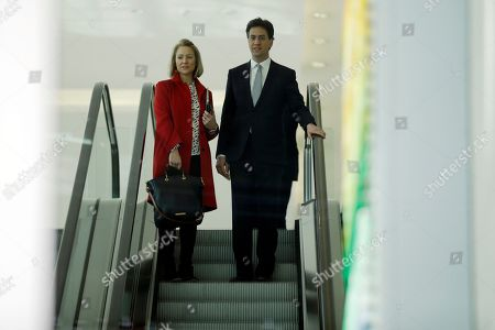 Stock Photo of The leader of the Labour Party Ed Miliband, right, travels down an escalator with advisor Rachel Kinnock after a press conference to launch his party's education manifesto in London, . Britain goes to the polls in a General Election on May 7