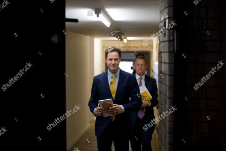 Nick Clegg, left, the leader of Britain's Liberal Democrats party and David Laws Minister of State for Schools walk out to the stage room for their party's manifesto launch in London, . Britain goes to the polls in a General Election on May 7