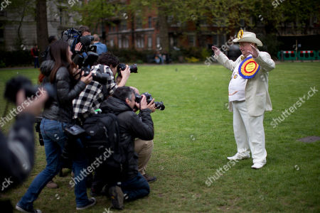 The leader of Britain's Official Monster Raving Loony Party (OMRLP) Howling Laud Hope, poses for photographers en route to give a television interview in London, . Britain goes to the polls in a General Election on May 7
