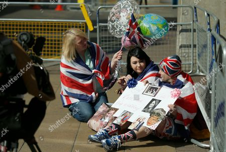 Stock Picture of Royal fans Maria Scott, left Amy Thompson, centre, and John Loughrey talk to a TV news outlet outside the Lindo Wing at St Mary's Hospital in London, . Kate, Duchess of Cambridge is expected to give birth to her second child later this month at the Lindo Wing maternity unit