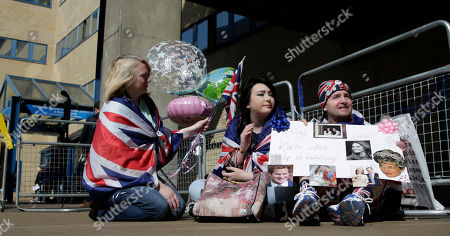 Royal fans Maria Scott, left Amy Thompson and John Loughrey wait outside the Lindo Wing at St Mary's Hospital in London, . Kate, Duchess of Cambridge is expected to give birth to her second child later this month at the Lindo Wing maternity unit