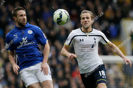 Tottenham Hotspur's Harry Kane, right, competes for the ball with Leicester's Matthew Upson during the English Premier League soccer match between Tottenham and Leicester City at White Hart Lane, London