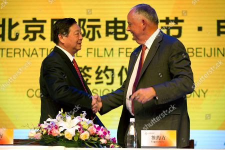 Stock Picture of Li Shilin, Dick Cook Li Shilin, left, head of China's CITIC Guoan, a unit of state-owned CITIC Group Corporation, and Dick Cook, former Walt Disney Studios Chairman and current head of Dick Cook Studios, shake hands after signing an agreement during a contract signing event held as part of the Beijing International Film Festival in Beijing, . Walt Disney Studios signed a deal with CITIC Guoan to invest $150 million into his new Dick Cook Studios