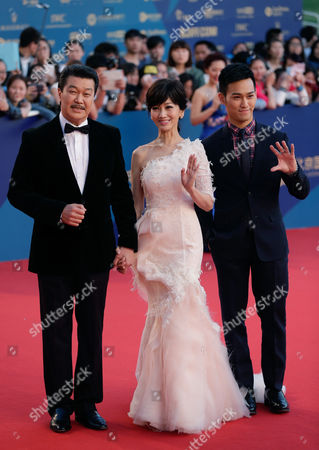 Angie Chiu, Melvin Wong, Wesley Wong Hong Kong actress Angie Chiu, center, walks with her husband Melvin Wong, left, and her son Wesley Wong on the red carpet as they attend the closing ceremony of the 5th Beijing International Film Festival in the Huairou district of Beijing
