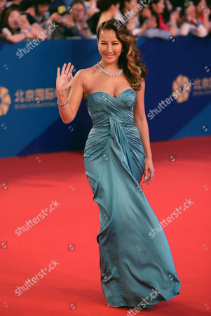 Coco Lee Taiwanese-American singer Coco Lee waves as she arrives on the red carpet for the closing ceremony of the 5th Beijing International Film Festival in the Huairou district of Beijing